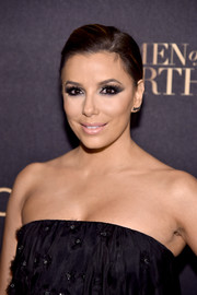 Eva Longoria attended the L'Oreal Paris Women of Worth celebration wearing her hair in a side-parted ponytail.