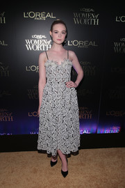 Elle Fanning charmed in a delicate white and black lace dress by Miu Miu at the L'Oreal Women of Worth celebration.
