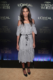 Liya Kebede teamed her cute frock with black ankle-wrap pumps.