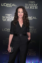 Andie MacDowell paired a Bottega Veneta patterned clutch with a back jumpsuit for the L'Oreal Women of Worth celebration.