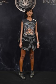 Liya Kebede teamed her shirt with a studded crossover mini skirt.