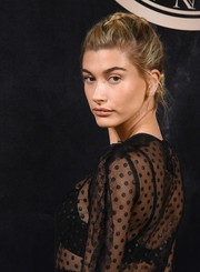 Hailey Baldwin styled her hair into a romantic French braid for the L'Oreal x Balmain party.