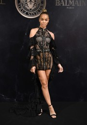 Jasmine Sanders complemented her dress with black satin ankle-strap sandals.