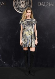 Doutzen Kroes went grunge-chic in a distressed graphic T-shirt dress at the L'Oreal x Balmain party.