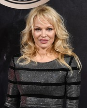 Pamela Anderson sported tousled curls at the L'Oreal x Balmain party.