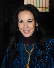 L'Wren Scott left her long hair flow in loose waves at her fall 2012 fashion show.