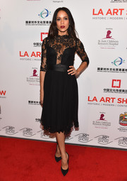 Dania Ramirez attended the LA Art Show Opening Night Premiere Party wearing a gorgeous LBD with a risque lace panel by Ludmila Corlateanu.