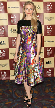 Brit Marling expertly paired her bold Balenciaga floral print dress with triple strap black leather peep-toes.