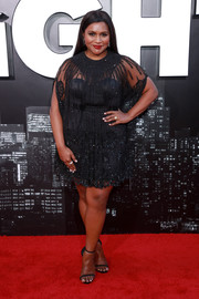 Mindy Kaling complemented her dress with black slim-strap heels by Stuart Weitzman.