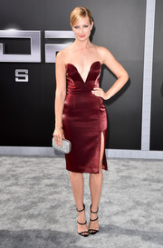 Beth Behrs took a daring plunge in this burgundy strapless dress during the LA premiere of 'Terminator Genisys.'