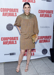 Demi Moore attended the LA premiere of 'Corporate Animals' looking chic in a micro-print dress with a metallic neckline.
