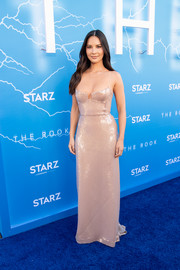 Olivia Munn showed off her flawless figure in a fitted blush sequin gown by Galvan at the LA premiere of 'The Rook.'