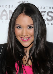 Manika brightened her makeup look at the premiere of 'Come Fly Away' by adding a long, feathery pair of false lashes.