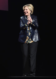 Hillary Clinton attended the Girls Build Leadership Summit wearing basic black trousers and a leather jacket.