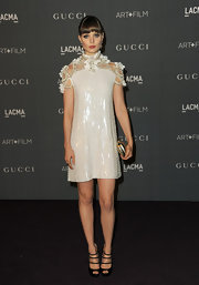 Bella Heathcote looked like a literal doll in this white adorned cocktail dress at the Art + Film Gala.