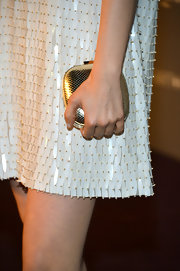 Bella Heathcote played up the beautiful golden beads on her dress with an equally elegant scaled clutch.