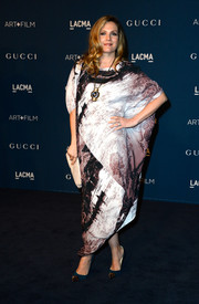 Drew Barrymore teamed her sophisticated gown with a pair of teal Christian Louboutin Geo pumps.