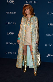 Linda Ramone was '60s-glam in a floor-length brocade coat layered over a gold mini dress at the LACMA Art + Film Gala.