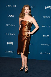 Amy Adams looked oh-so-sophisticated in a shimmery bronze strapless dress by Gucci during the LACMA Art + Film Gala.
