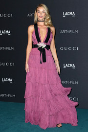 Rosie Huntington-Whiteley amped up the sweetness at the LACMA Art + Film Gala in a rose-colored Gucci gown featuring a tiered design and a bowed black waistband and shoulder straps.