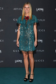 Gwyneth Paltrow was an explosion of sequins and ruffles in this teal Gucci mini dress during the LACMA Art + Film Gala.