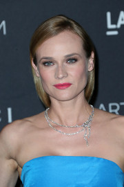 Diane Kruger's pink lipstick provided a gorgeous contrast to her blue outfit.