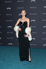Amber Valletta oozed classic glamour at the LACMA Art + Film Gala in a strapless black gown styled with a fur stole.