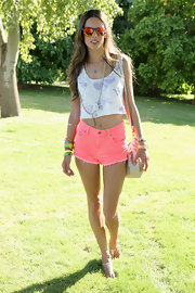 A pair of neon pink cutoff shorts topped off Alexandra Ambrosio's look at Coachella.