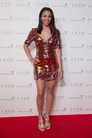 Corinne Foxx got glitzed up in a gold sequin mini dress for the LAVO Singapore grand opening.