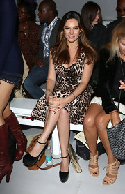 Kelly Brook paired her wildly printed dress with sky-high platforms.