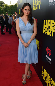 Molly Gordon looked sweet and elegant in a pleated blue cocktail dress by Prada at the world premiere of 'Life of the Party.'