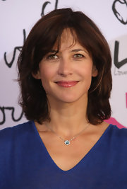 Sophie Marceau's light pink lip gloss left her face looking natural with just a touch of sparkle and color.