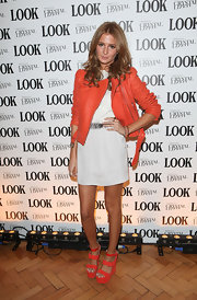 Millie Mackintosh combined 'sweet and tough' matching her flowy minidress with an orange leather jacket from Carven.