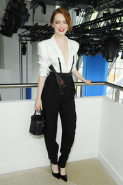 Emma Stone teamed her outfit with a round leather purse, also by Louis Vuitton.