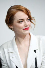 Emma Stone styled her hair into a romantic loose updo for the LVMH Prize 2018.