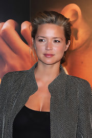 Virginie Efira wore a sheer berry lipgloss for a hint of color and shine at the Paris premiere of 'La Delicatesse.'