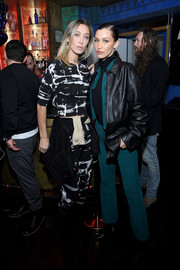 Bella Hadid attended the La Detresse launch party wearing an oversized black leather jacket by Holzweiler.