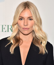 Sienna Miller looked oh-so-pretty with her boho waves at the La Mer by Sorrenti campaign.