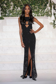 Jourdan Dunn looked sultry and sophisticated at the La Perla fashion show in an embellished cutout gown with a cleavage-baring cutout and a high front slit.