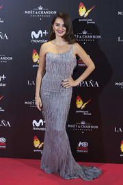 Penelope Cruz brought some Old Hollywood glamour to the Madrid premiere of 'La reina de Espana' with this fringed and beaded one-shoulder gown by Atelier Versace.