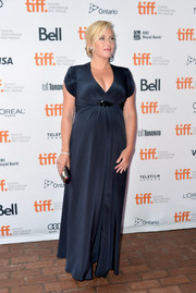 Kate Winslet showed off her elegant maternity style with this low-cut black gown during the premiere of 'Labor Day.'