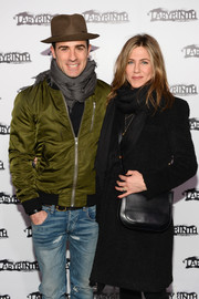 Jennifer Aniston looked super cozy wearing this black scarf and wool coat combo at the Celebrity Charades Gala 2015.