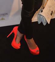 Hayden took the neon trend for a spin in a pair of electric orange patent leather pumps.