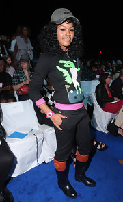 Teyana Taylor's bubble gum pink watch is the perfect accessory to her playful Lacoste sweater. Who knew alligators wore pink too?