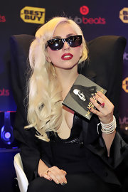 Lady Gaga styled her blond locks in soft curls at the signing of her 'Monster' CD.