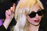 Lady Gaga showed off her cool patterned minx manicure while signing copies of her 'Monster' CD.