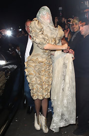 Lady Gaga accessorized with a nude lace veil for added drama!