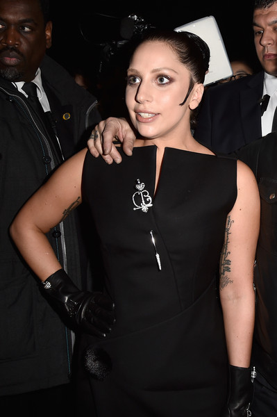 Lady Gaga Leather Gloves [show,little black dress,dress,fashion,formal wear,event,suit,fashion accessory,cocktail dress,haute couture,tuxedo,lady gaga,front row,part,paris,france,balenciaga,paris fashion week womenswear fall]