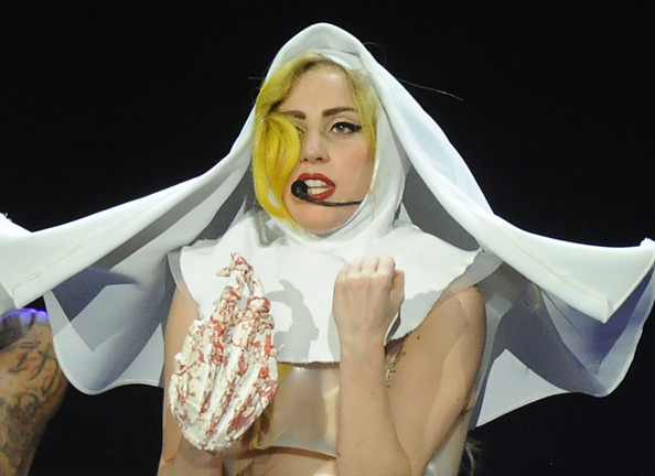 Lady Gaga Headdress [white,head,beauty,hand,mouth,jaw,fashion accessory,performance,animation,gesture,lady gaga,editorial,archives,arena at gwinnett center,georgia,duluth,lady gaga in concert,the monster ball tour]