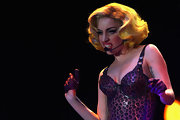 The singer, who wears wigs to reflect her mood, sported a short, waved, Marilyn-style look while on stage in a leopard bustier.